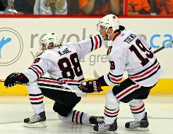 Patrick Kane and Jonathan Toews react to Kane's Game 3 goal during the Stanley Cup Final.