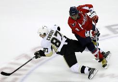 Alex Ovechkin (8) runs into Sidney Crosby during one their several NHL confrontations last season.