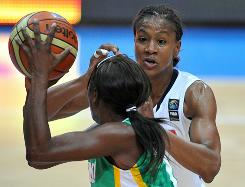 Team USA's Tamika Catchings defends Senegal's Salimana Diatta during their game on Friday. Catchings tallied nine points, five rebounds and three assists.