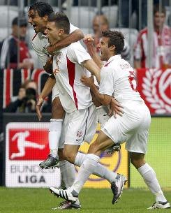 Mainz's Adam Szalai, center, celebrates his goal against Bayern Munich with teammates Sami Allagui, left, and Marco Caligiuri. Mainz has won all six of its Bundesliga matches this season.
