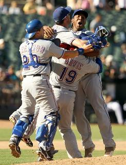 The rangers celebrate the after the final out clinched the AL West title and their first playoff berth in 11 years.