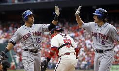 Mets' Carlos Beltran, left, celebrates with Nick Evans, right, after Beltran's two-run home run off Phillies pitcher Ryan Madson.