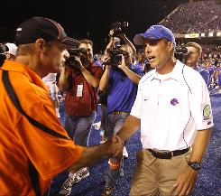 "Boise State coach Chris Petersen, right, said his team is ""not going to play to outside noise"" in reference to his third-ranked Broncos becoming the first school outside the six major conferences to play in the Bowl Championship Series title game."