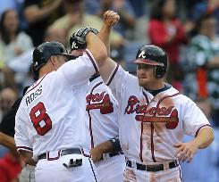 The Braves' Brooks Conrad, right, celebrates with teammate David Ross after hitting a three-run homer in the third inning.