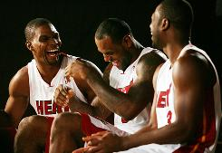 Heat teammates (from left) Chris Bosh, LeBron James and Dwyane Wade laugh as they answer questions during the Miami Heat's media day.