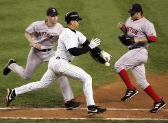 The Yankees' Alex Rodriguez was called out for using his hand to intentionally knock the ball out of the glove of Red Sox pitcher Bronson Arroyo, left, during Game 6 of the 2004 AL Championship Series.