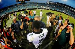 Eagles quarterback Michael Vick leaves the field after the Eagles defeated the Jaguars 28-3 on Sunday. Vick threw three touchdown passes.
