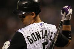 Carlos Gonzalez posts a stat line of 34 home runs, 25 stolen bases and a .340 batting average in his first full season, which has exceeded even optimistic expectations.