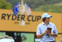 Rickie Fowler makes notations in his yardage book during a practice round Tuesday at Celtic Manor in advance of the Ryder Cup beginning Friday in Newport, Wales. Fowler is one of five Ryder Cup rookies on the U.S. team.