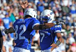 Air force tight end Chaz Demerath, left, and quarterback Tim Jefferson celebrate a win vs. Brigham Young on Sept. 11. The Falcons are 3-1 heading into Saturday's clash against Navy.