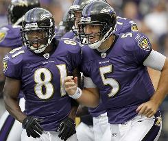 Ravens wide receiver Anquan Boldin, left, and quarterback Joe Flacco run off the field after the two connected for a score in Baltimore's win against the Browns.