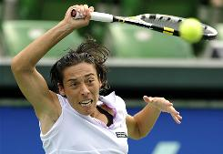 Francesca Schiavone of Italy raps a forehand during her victory against Japan's Kimiko Date Krumm on Wednesday during the third round of the Pan Pacific Open in Tokyo.
