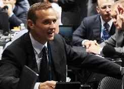 Tampa Bay Lightning general manager Steve Yzerman works the floor during the June draft. His arrival has created excitement about the franchise.