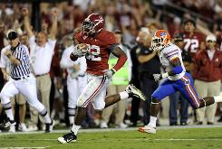 Alabama linebacker C.J. Mosley takes his interception of Florida quarterback John Brantley's pass to the end zone for a third-quarter touchdown at Bryant-Denny Stadium.