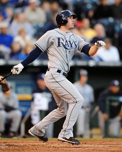 Matt Joyce connects on a two-run triple in the first inning that helped the Rays defeat the Royals and tighten the race for first place in the AL East