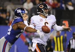Chicago Bears quarterback Jay Cutler was sacked nine times and knocked out of the second half with a concussion, as the Giants rattled the Bears' offense and picked up a 17-3 win.
