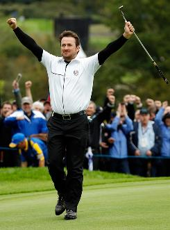 Graeme McDowell of Europe celebrates after he and partner Rory McIlroy secured a 3 and 1 victory against Zach Johnson and Hunter Mahan during a foursome match Sunday at the Ryder Cup in Newport, Wales.