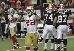 Nate Clements (foreground) and the 49ers fell to 0-4 on Sunday after losing to the Falcons.