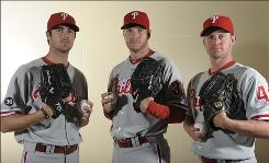 The Phillies will rely heavily on their three star pitchers  (from left) Cole Hamels, NL Cy Young favorite Roy Halladay, and Roy Oswalt  in the playoffs. The Phillies are trying to get back to the World Series for a third consecutive year, having won in 2008 and lost to the Yankees last year.