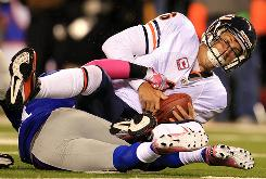 Jay Cutler was sacked nine times before leaving Sunday's game against the Giants with a concussion.