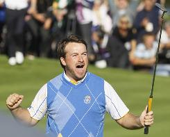 Graeme McDowell celebrates after knocking in a birdie putt on the 16th hole to extend his lead to 2 up on Hunter Mahan. McDowell won the match on the next hole, securing Europe's victory in the Ryder Cup on Monday at Celtic Manor in Newport, Wales.