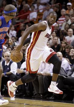 Dwyane Wade's preseason debut lasted all of three minutes. He left the Heat's game against the Pistons with a strained hamstring.