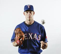 Rangers ace Cliff Lee has pinpoint control  he struck out 185, walked 18.