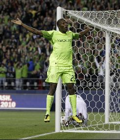 The Sounders' Sanna Nyassi celebrates his second-half goal against the Columbus Crew in the U.S. Open Cup soccer final Tuesday in Seattle. The Sounders won 2-1.
