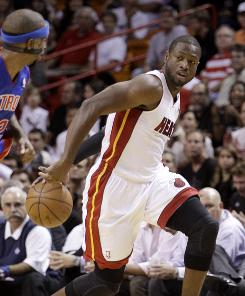 Dwyane Wade, right, left the Miami Heat's preseason opener after just three minutes on the court with a strained hamstring, an injury he says will keep him out for at least the next week.