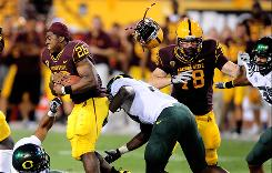 Arizona State running back Cameron Marshall loses his helmet against Oregon last month. In the NCAA, a play ends if a ballcarrier's helmet comes off.