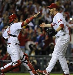 Roy Halladay pitched a no-hitter against the Reds in Game 1 of a NLDS at Philadelphia, falling one walk shy of joining Don Larsen as the only players with postseason perfect games.