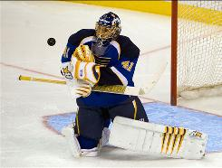Jaroslav Halak, making a save Sept. 21 during a preseason game against the Avalanche, is the Blues' new No. 1 goalie.
