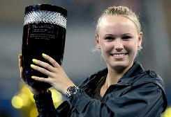 Caroline Wozniacki of Denmark celebrates securing the world No. 1 ranking on the WTA Tour after her win against Petra Kvitova the Czech Republic at the China Open in Beijing.