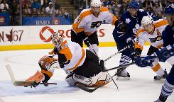 Michael Leighton's back issues became more pronounced during this preseason game against the Toronto Maple Leafs.