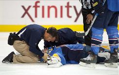 Thrashers goalie Ondrej Pavelec is attended to by a team trainer after falling to the ice during the first period against the Capitals at Philips Arena. Pavelec lost consciousness and was taken to a hospital for further evaluation.