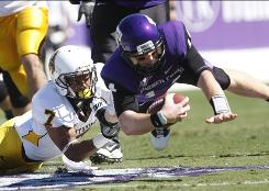 TCU quarterback Andy Dalton, right, dives ahead during the No.5 Horned Frogs' victory over Wyoming. Dalton passed for a season-high 270 yards and three touchdowns to lead TCU to its second consecutive shutout.