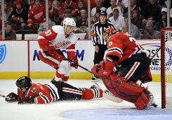 Detroit Red Wings center Valtteri Filppula watches his shot slip past Blackhawks goalie Marty Turco during the third period in Chicago. Detroit won 3-2.