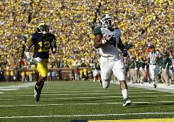 Michigan State's Edwin Baker reaches the end zone after his touchdown run in the first half against Michigan.