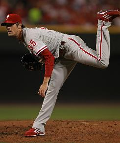 Phillies starter Cole Hamels closed out the National League Division Series with a 2-0 victory over the Reds.