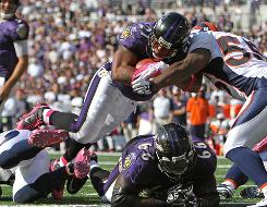 Ravens RB Ray Rice lunges for a second-half touchdown against the Broncos on Sunday.
