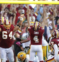 Redskins K Graham Gano celebrates his game-wining field goal against the Packers on Sunday.