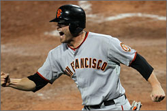 Giants' Freddy Sanchez reacts after scoring the go-ahead run in the top of the ninth inning.