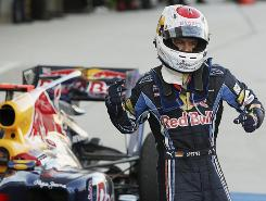 Sebastian Vettel celebrates his win at the Japanese Grand Prix Sunday after he held off teammate Mark Webber for the victory.