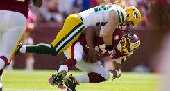 Washington quarterback Donovan McNabb is sacked by Green Bay linebacker Clay Matthews.