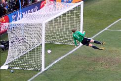 Manuel Neuer of Germany watches the ball bounce over the line from a shot that hit the crossbar against England during a June 27 World Cup match, but referee Jorge Larrionda did not award the English the goal. This controversial play is being cited as one of the reasons FIFA is looking into goal-line technology.