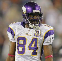 Randy Moss caught four passes for 81 yards and a touchdown in his first game back with the Minnesota Vikings.