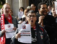Liverpool fans protest against American owners Tom Hicks and George Gillett Jr. outside the High Court in London on Tuesday.