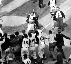 A joyous greeting awaits Bill Mazeroski, about to score the winning run of the 1960 World Series. It's the only World Series Game 7 to end on a home run.