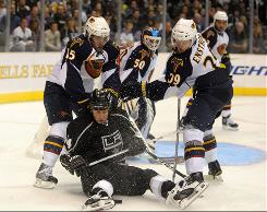 Los Angeles Kings left wing Ryan Smyth (94) battles for the puck with Atlanta Thrashers right wing Nigel Dawes (15), left, and defenseman Tobias Enstrom (39) in the third period at the Staples Center. The Kings defeated the Thrashers 3-1.