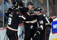 Bobby Ryan, Ryan Getzlaf, center, and Corey Perry celebrate one of two third-period goals that helped the Ducks earn their first win of the season after starting out 0-3-0.